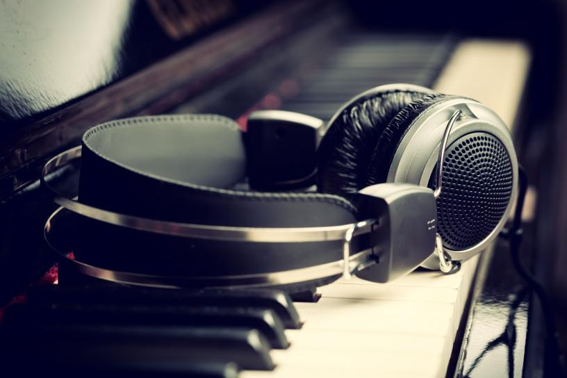 Headphones laying on piano.