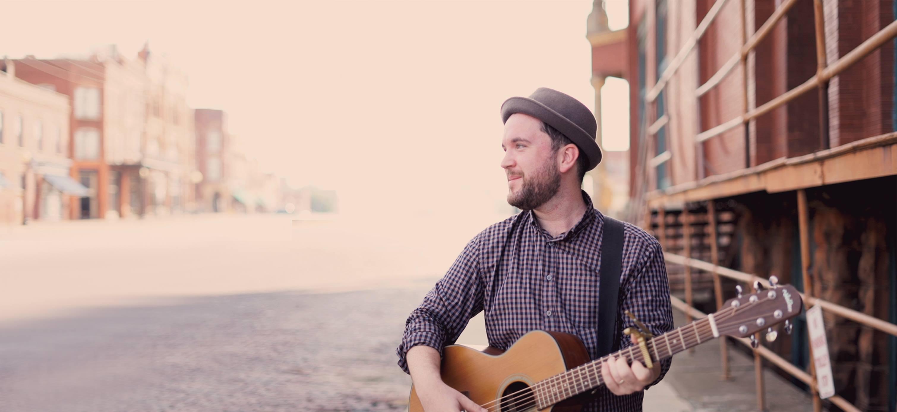 Folk Singer holding guitar.